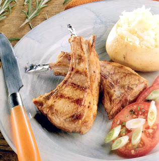 Lamb Cutlets with Rosemary: Classic barbecue dish of lamb cutlets with rosemary served with boiled potatoes and sliced spring onions