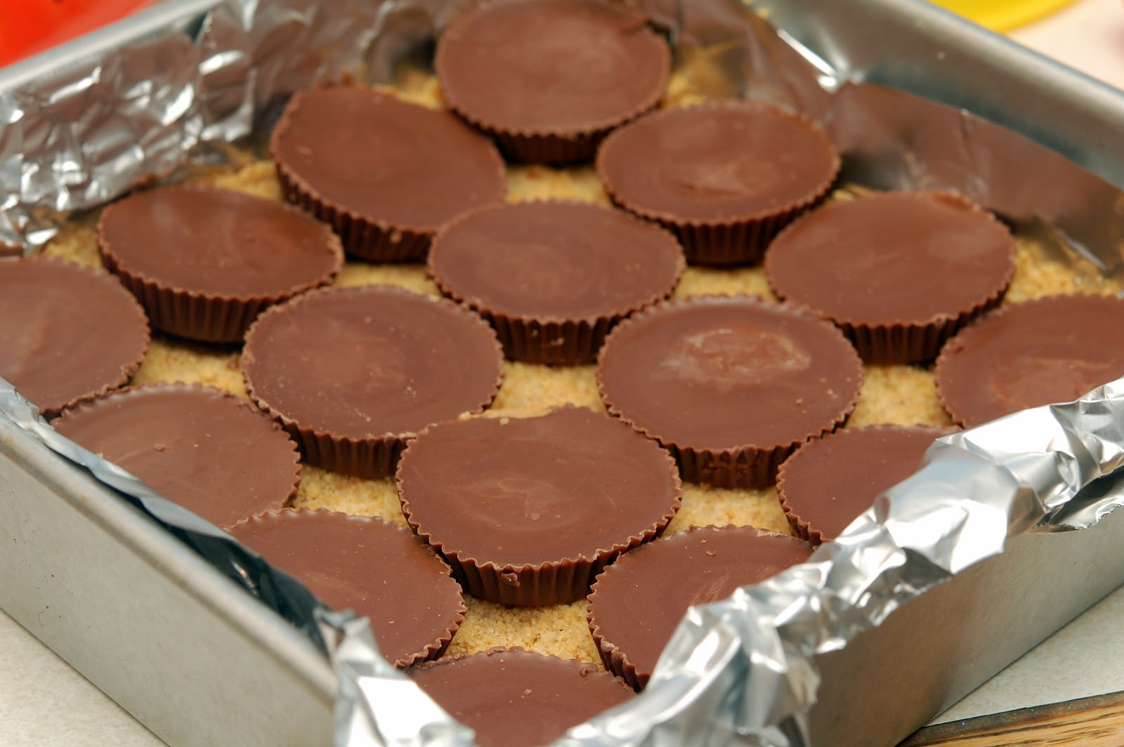 PEANUT BUTTER CHEESECAKE OVER PEANUT BUTTER CUPS SITTING ON A ...