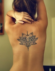 Flower tattoo on back middle body