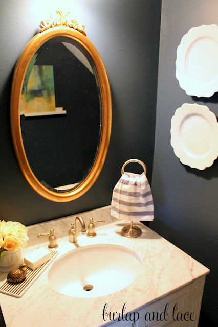 Your beautiful bathrooms from thrifty decor chick for Blue and gold bathroom accessories