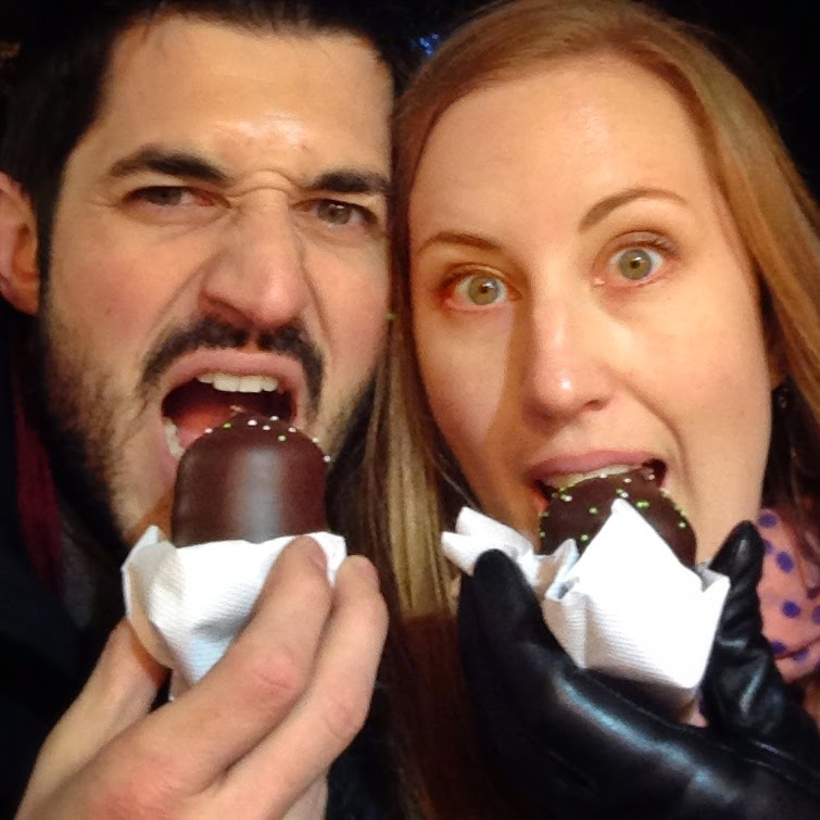 Eating marshmallow at the winter christmas markets in paris