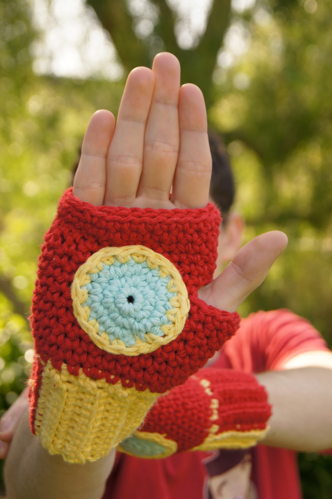 A free crochet tutorial and pattern for Iron Man fingerless mittens. I saw pictures of these mitts on the internet and designed my own simple pattern.