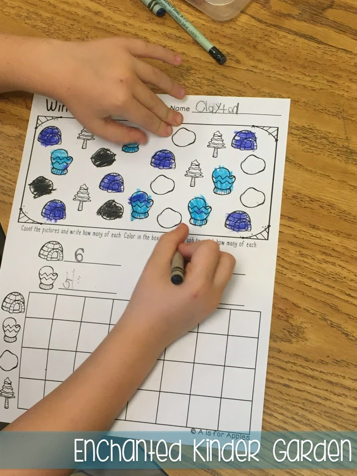This is a photograph of a student completing a kindergarten graphing activity.