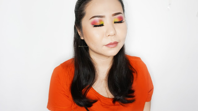 Colorful neon makeup tutorial with Urban Decay Electric Palette using red, yellow, orange, blue and green neon colors. A super pigmented neon colors with an amazing blending ability to make the cool and warm colors blend in together.