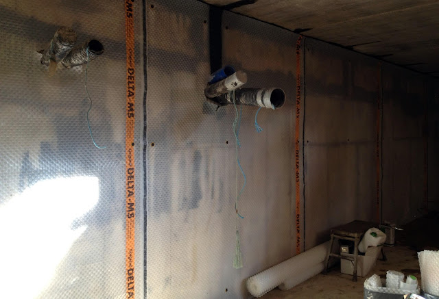 the basement tanking membrane is being fitted