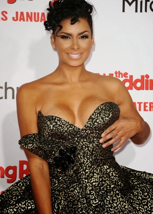 Reality star Laura Govan suffers wardrobe malfunction on the red carpet, nipples pop out