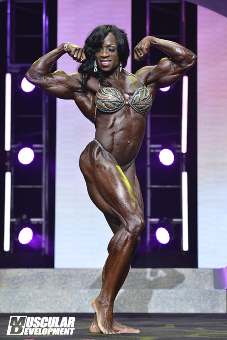Iris Kyle IFBB Pro Female Bodybuilder Flexing Muscles Image 2