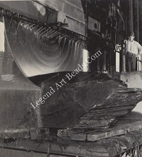 An 85 inch (2.2 meters) diameter circular saw blade, whose cutting teeth contain De Beers diamond grit, saws through a block of Welsh slate at high speed.