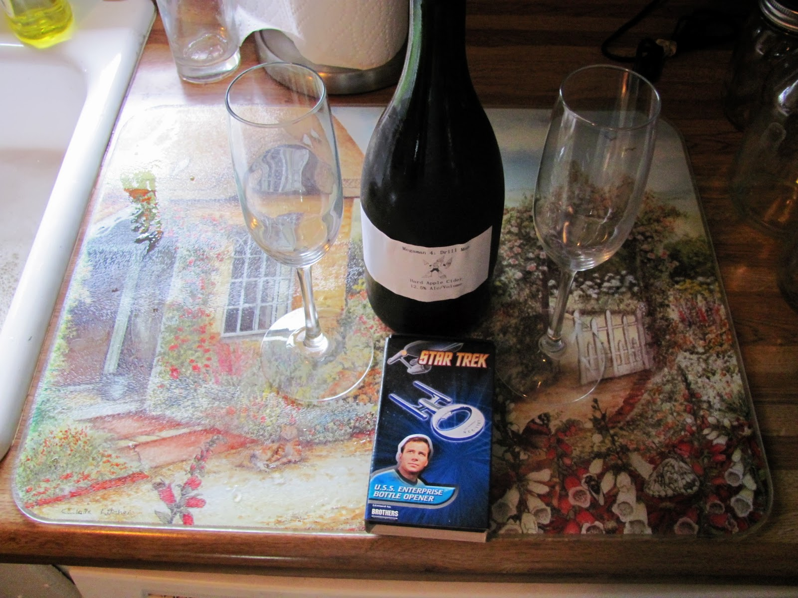 Drill Man apple cider with Star Trek bottle opener and champagne flutes
