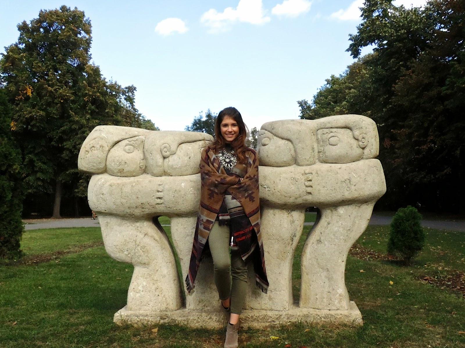 Autumn fashion with Brancusi style romanian statue