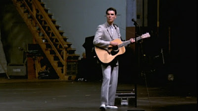 David Byrne on an empty stage in Stop Making Sense