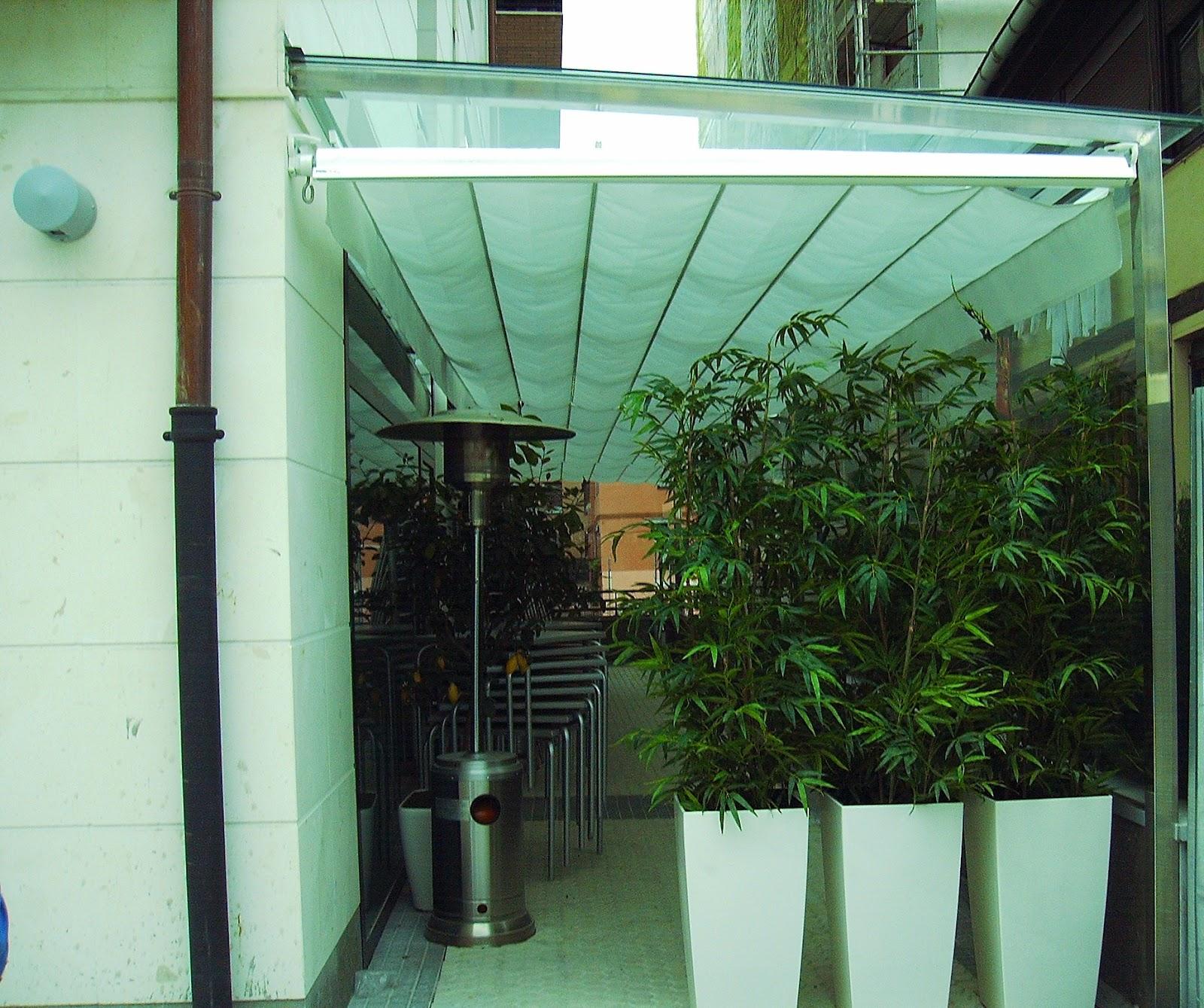 Terrazas climatizadas para hosteleria terraza acristalada for Estructura de toldo