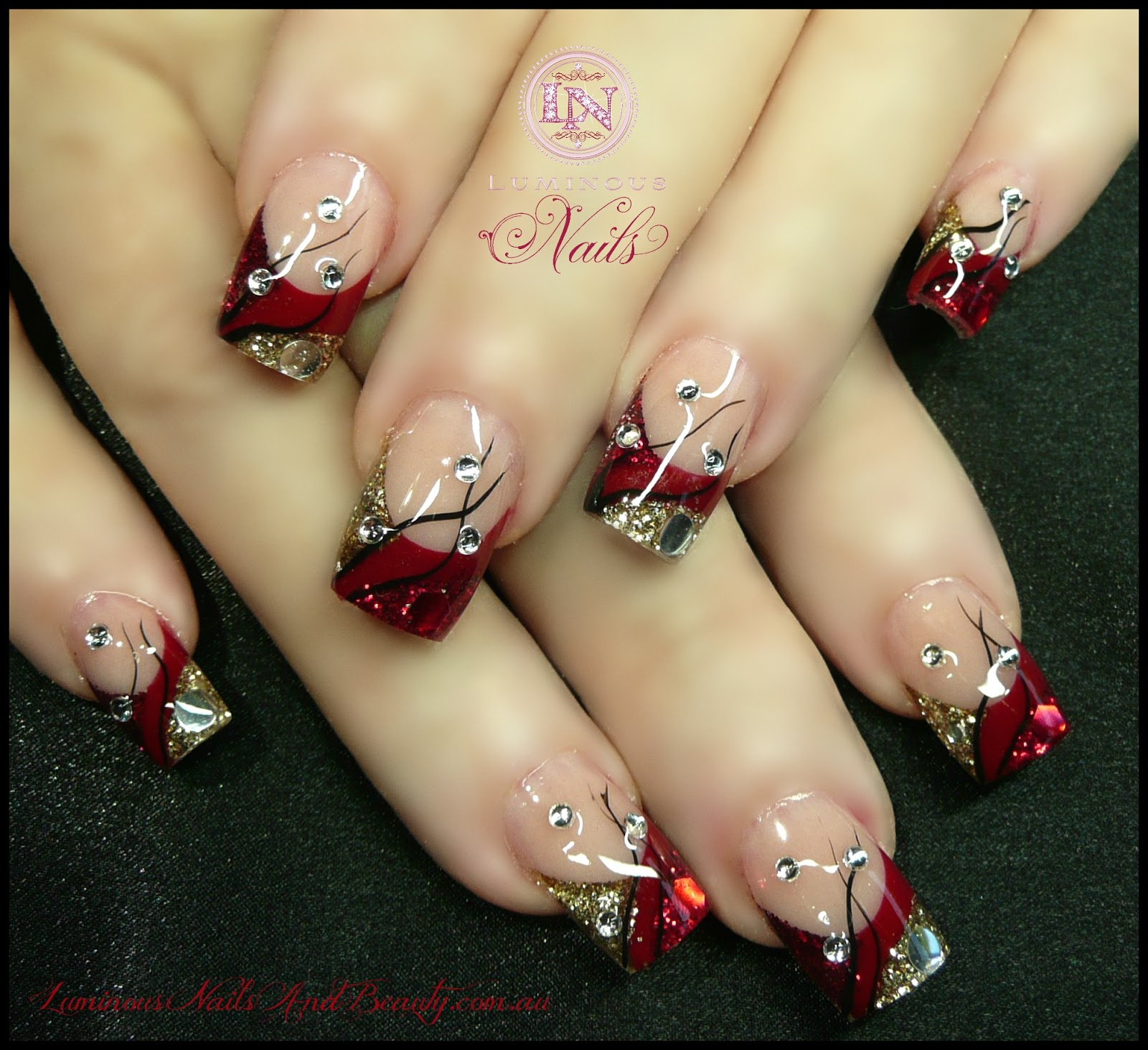 The Excellent Black nails with glitter gold design Photograph