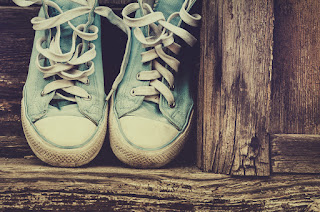A pair of old sneakers that, like old habits, are hard to toss out unless you work through developing and adopting new habits through action learning