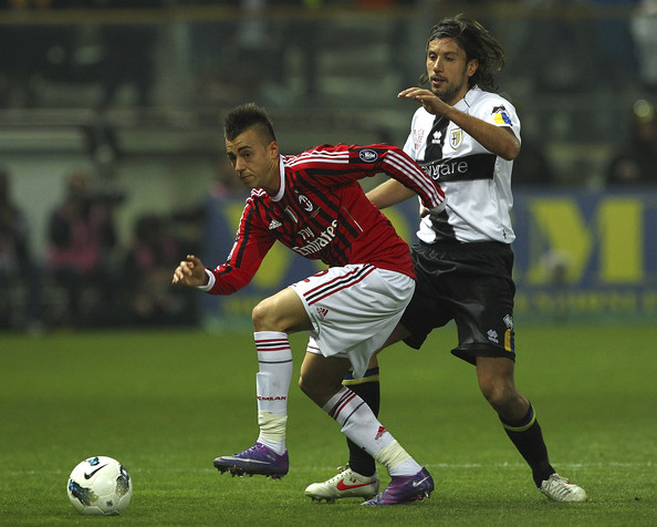 Stephan El Shaarawy of AC Milan competes for the ball with Cristian