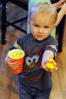 toddler with mini rubber ducky