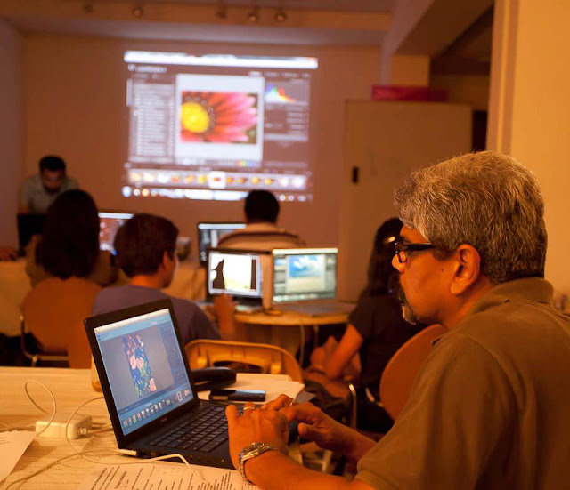 Adobe Photoshop Lightroom is becoming more popular among Indian Photographers and most of the passionate Photographers want to leverage the power to this wonderful software by Adobe, instead of handing their creative shots to a professional editor to process. We recently concluded a two Workshop at APEX, Delhi and this Photo Journey tries to show the flow of Digital Information in a very interesting environment...This was third Workshop with APEX and this one had maximum participation... We had few more interested people but there was an upper bar, so need to plan another one soon. The first workshop at APEX happened in April 2011 and that one was most interactive one.Diversified Photo Enthusiasts participated in this workshop - School kids, serious Amateur photographers, new Pro-photographers and some of the popular Indian Photographers, who have already been into Lightroom processing. Apart from photographers, there were some folks from journalism & Art-gallery expertsThis was a hands on workshop focusing on two most important modules of Lightroom - LIBRARY & DEVELOP ! But we almost discussed most of the rooms in Lightroom. At times, we also jumped into Color-Management, which is one of the vast area to understand.I have been involved in many other workshops in Delhi, but this one was very well organized by new team of APEX- Delhi (Academy of Photography Excellence). Each participant in the workshop was very passionate about photography and interested in adding organizing & processing skills. Check out expressions of three of the participants above Most of the folks had come with their Laptops. Some of the folks were already using Lightroom 3 and few of them had moved to 4th version. During the workshop we mainly talked about common functionality and dicussed new things of Adobe Photoshop Lightroom4, including Process Version, Book Module & Map ModuleProcess Version 2012 was discussed in details and how it can add more value to a Photographer's workflow. Most of the photographs shared in this Photo Journey are clicked by Aditya Srya and Dinesh Khanna. So credits go to both of them !!This workshop happened in a basement gallery at Academy of Photography Excellence, Vasant Vihar, Delhi !One of the sincere participants, who had lot of inetersting questions during this two days workshop on Lightroom. Great to meet people with different thoughts and who dabble in different styles of photography.Presence of Professional Photographers made many discussions more interesting. As they deal with different types of workflows as compared to Amateurs. Some of them were more into Printing, so wanted to know more in terms of Color Management and Profiles.During the workshop I realized that most of the folks were using Lightroom only for processing their photographs and this was first time, they thought of Organizing/Managing their Photo-shoots through this magical software which provides integral behavior of organizing & processing in same workspace. At the same time, few of them were attending to know more about the organizing capabilities of this software, as they were already using it for organizing the photographs in Adobe Photoshop Lightroom.During the workshop there were some interesting discussions around Digital Photography in general and it was great to hear Professional Photographers to talk about it. Because they are the one who have spent many years on films and then moved to Digital world of Imaging. It was to great to hear their thoughts on power of Digital Imaging with unparalleled complexities involvedDinesh Khanna is an active user of Adobe Lightroom and he added lot of interesting things about Lightroom during these days. He is quite comfortable with keyboard shortcuts in Lightroom and spent some time explaining easy-to-remember keyword shortcuts of Adobe Photoshop Lightroomgeneral chit-chat during breaks @ APEX, Vasant Vihar, DelhiIn the same hall, an exhibition was going on by Ashish Chawla. Although some of his work was yet to be placed on other walls. Ashish was also there to attend the workshop with his designer.Some of the folks were more interested in archiving, so we had detailed discussion around Catalogs, their capabilities & max limits. Interestingly there were folks who were having 1,18,000 + files in one catalog. Interesting to know such Photographers, who are utilizing Lightroom at it's best It was great to hear Aditya Arya and Dinesh Khanna during various topics we discussed about Adobe Photoshop Lightroom. Some thoughtful views around old ways of Dark-room processing and new era of Digital processing in softwares like Lightroom, Photoshop, Aperture etc. It was great to see lot of energy and passion about Photography in these two days !!!Looking forward to more such interactions at APEX, in form of group workshops & 1:1 sessions, which we are planning in near future.
