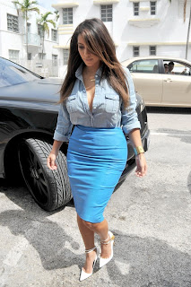 Kim Kardashian denim shirt tucked into a blue skirt