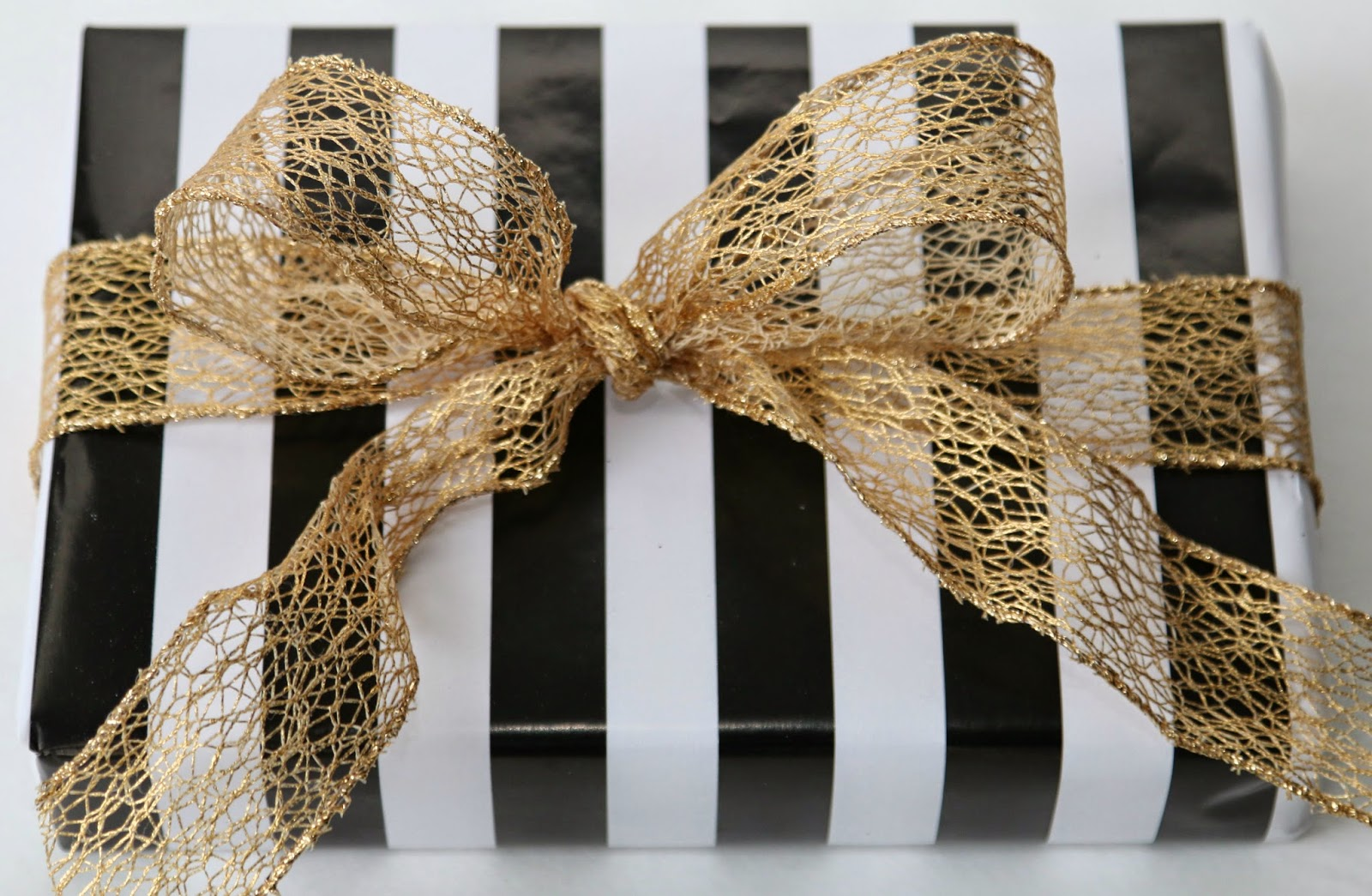 Black and white stripped paper with gold web ribbon