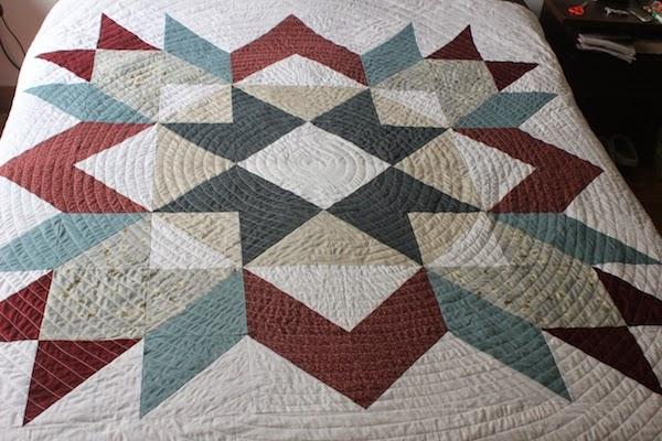 patchwork quilt con diseño estrella de carpintero