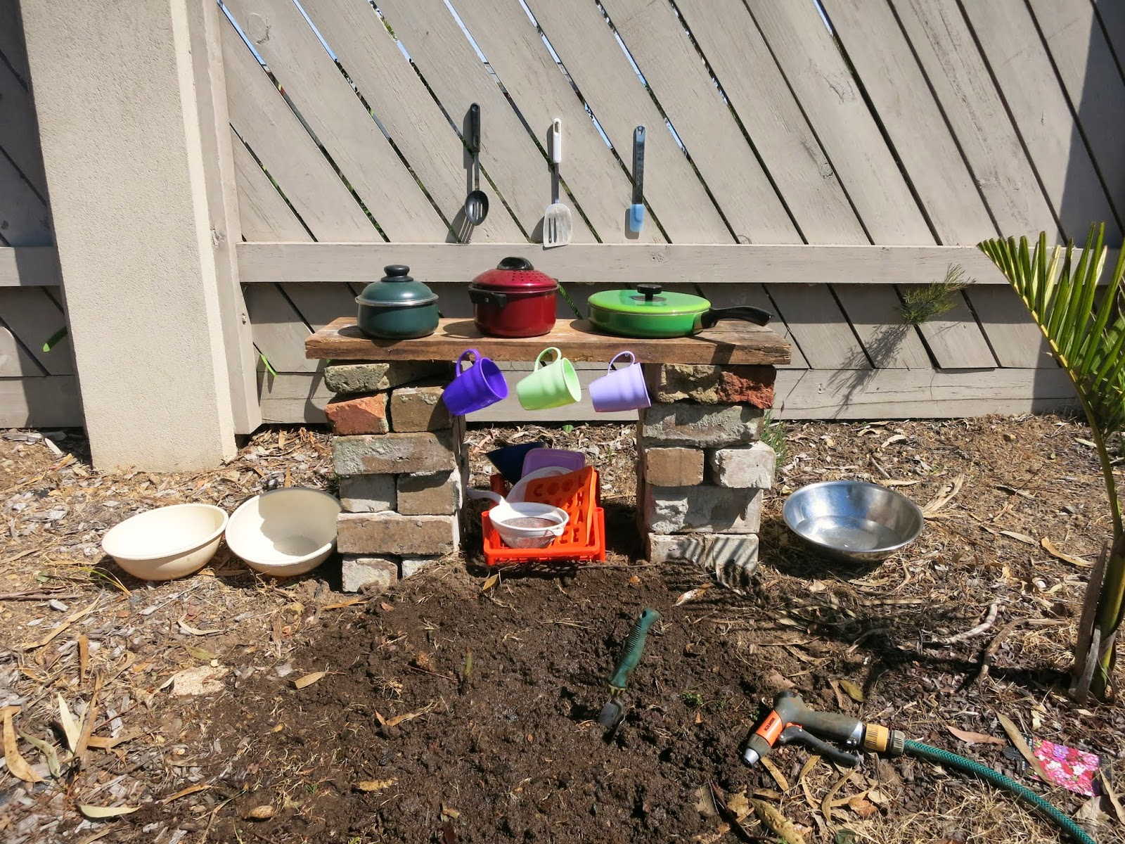 Learn with play at home make your own simple backyard mud for Simple diy kitchen ideas