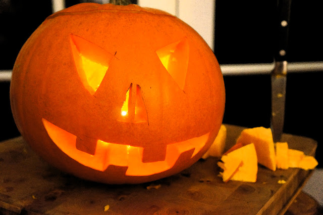 Picture of a Jack O Lantern on a Cutting Board with a Knife