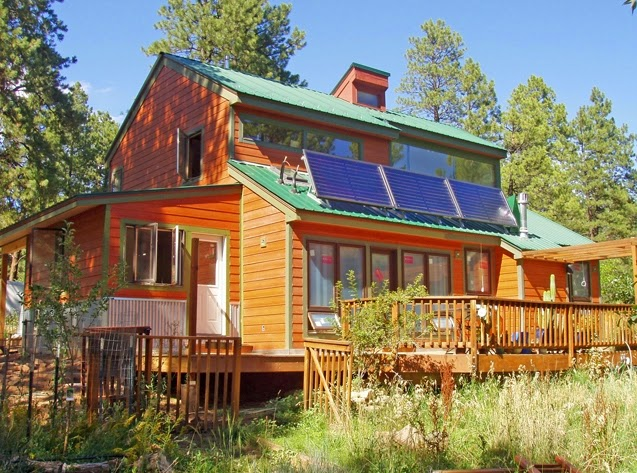 Passive solar house plans with greenhouse home design inside for Solar cottage plans