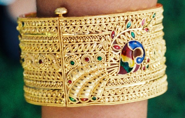 Gold Bangle bracelet with Peacock design