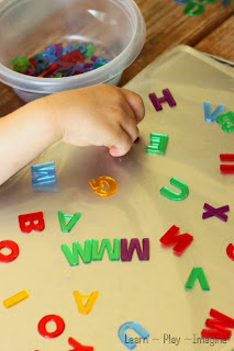 Letter recognition in preschool with a sticky alphabet tray.