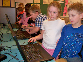 Ms.Cassidy's students working at a computer station
