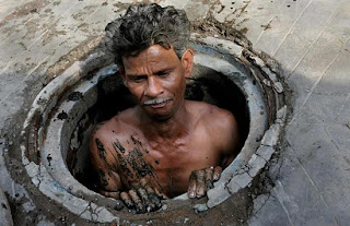 Man in manhole covered in you-know-what