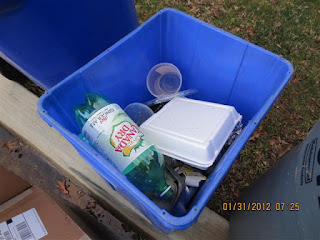 Foam food container in blue recycling bin