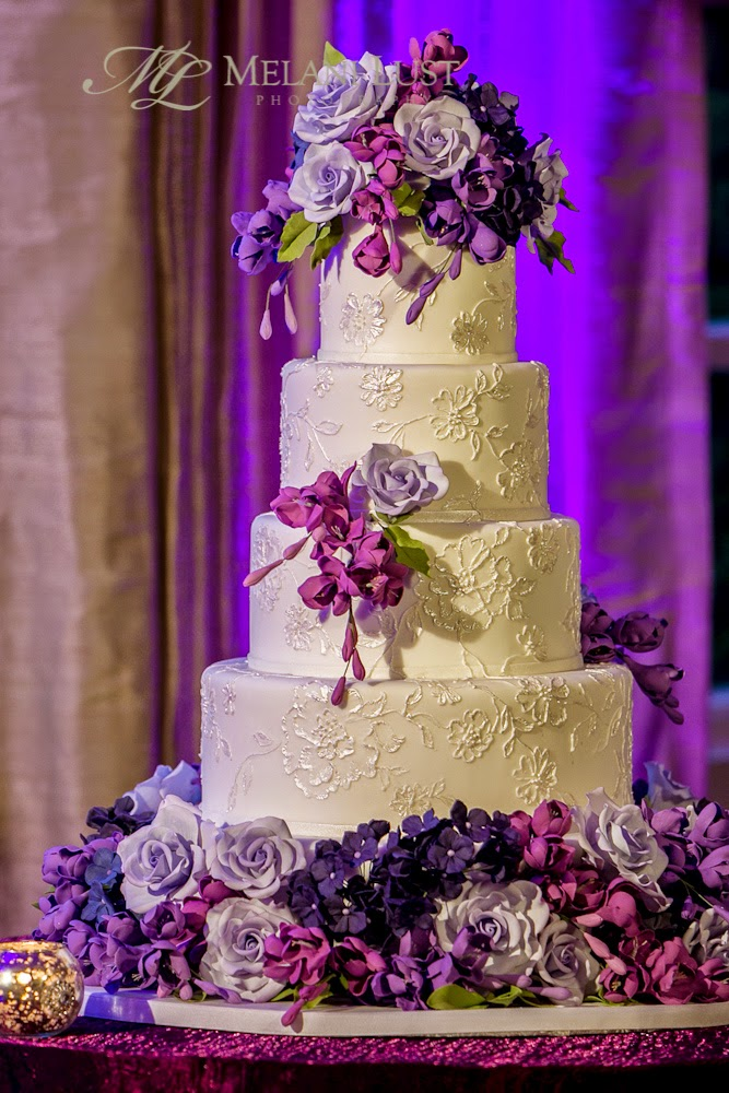 white ct wedding cake with purple sugar flowers