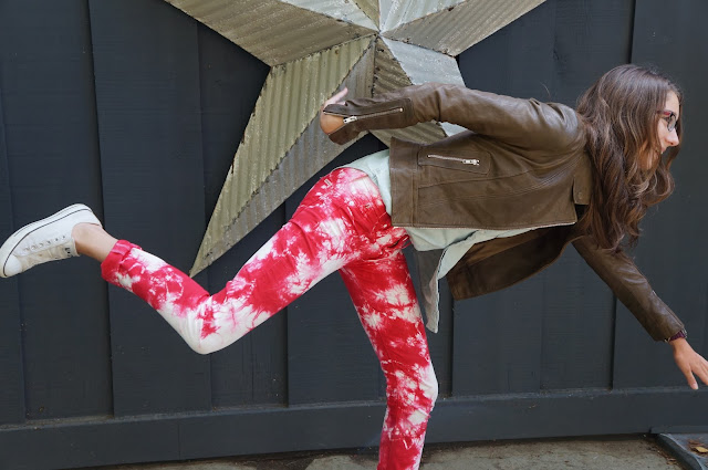 Hudson red tie-dye jeans, white laceless beat-up converse, olive brown Aritizia leather jacket, light was TNA denim shirt, candid yoga shot, goofing off on the shoot