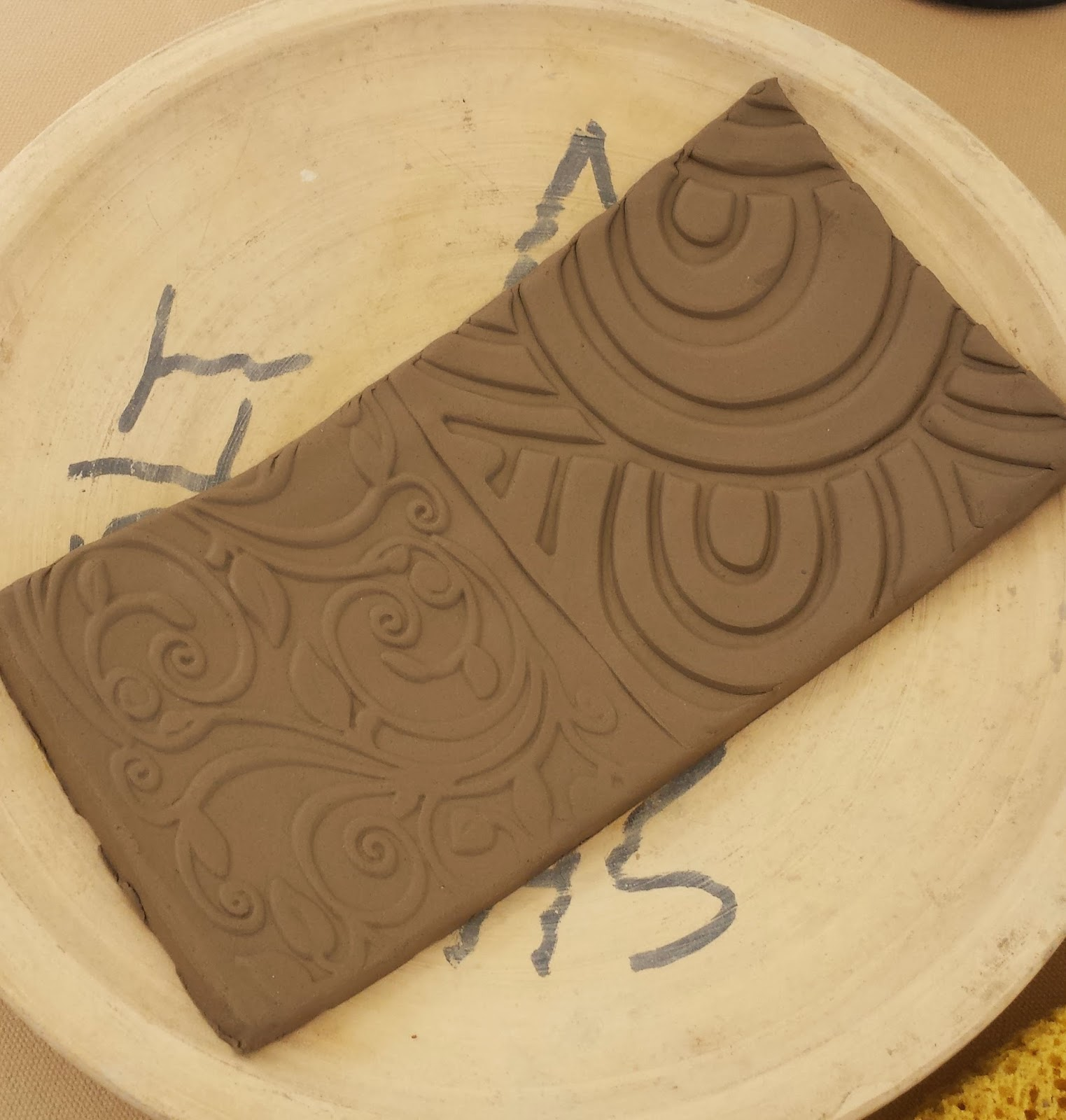 Handmade stoneware clay sushi plate in progress.