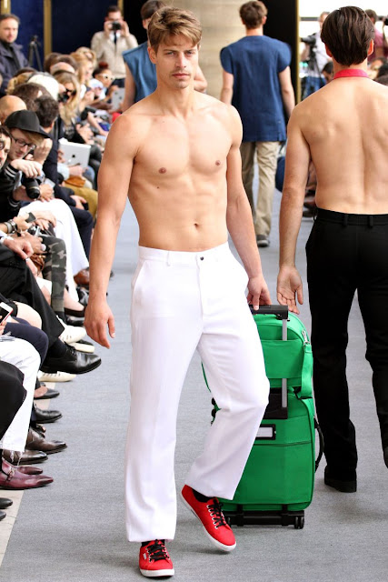 Shirtless male model on the runway