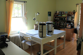 View of craft room with tables and desk.