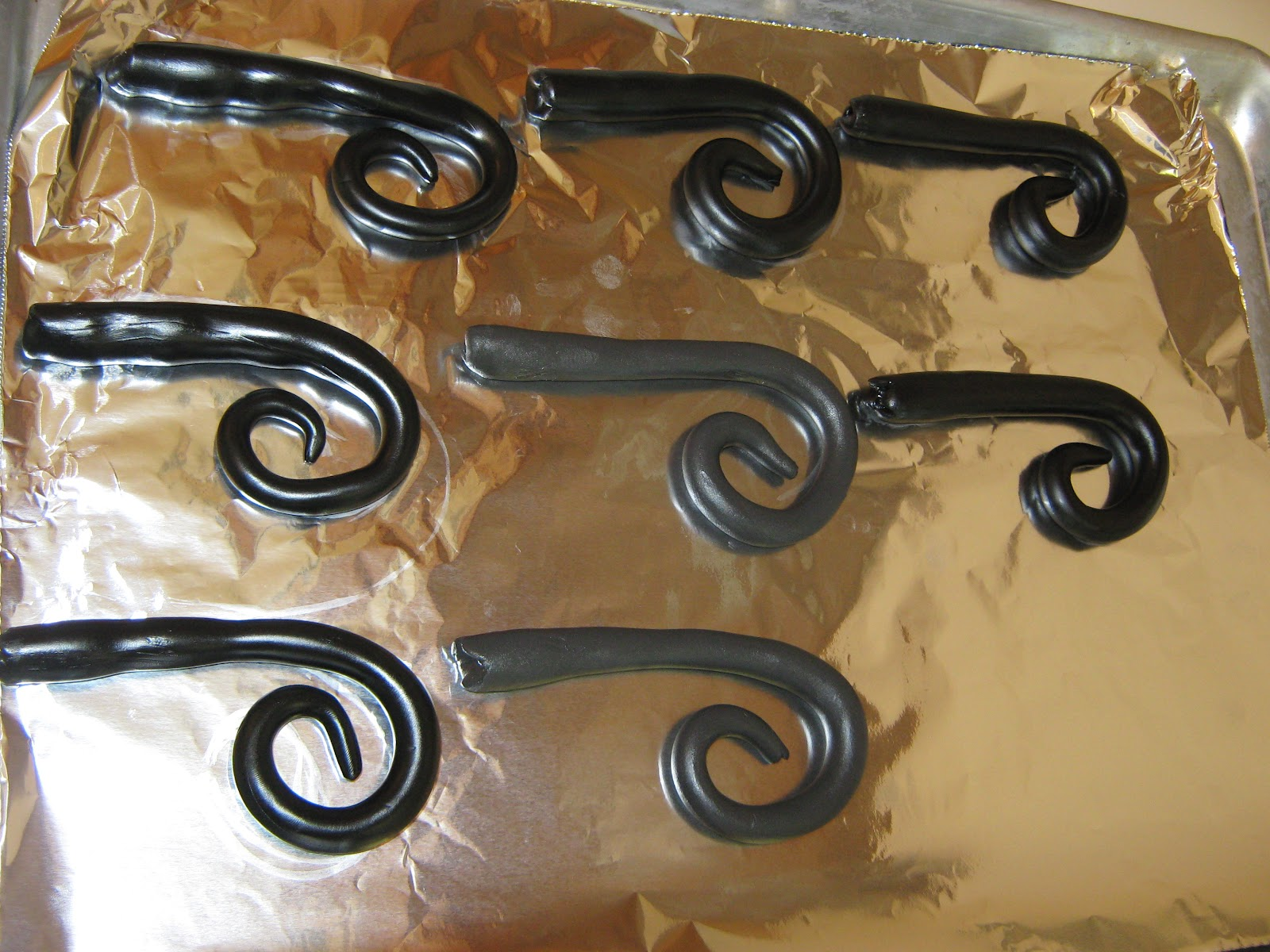 Wrought iron drapery rods -  Pottery Barn Cast Iron Curtain Rods Tutorial