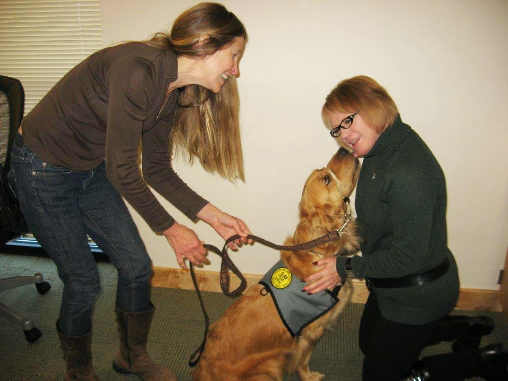 Karyn and Ceili (Golden Retriever) interact with Kathy Loter of DoveLewis