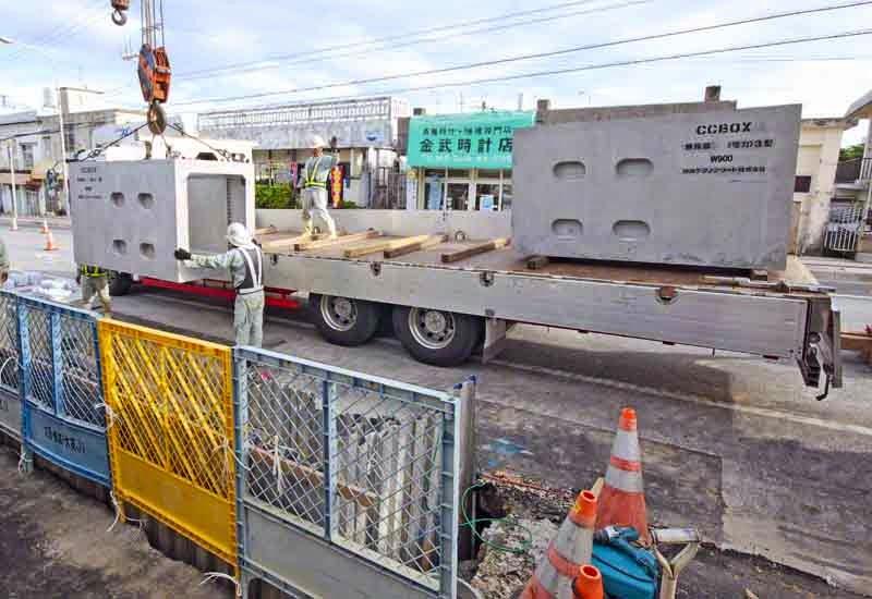 contractors,crane,huge cement block, hole in sidewalk