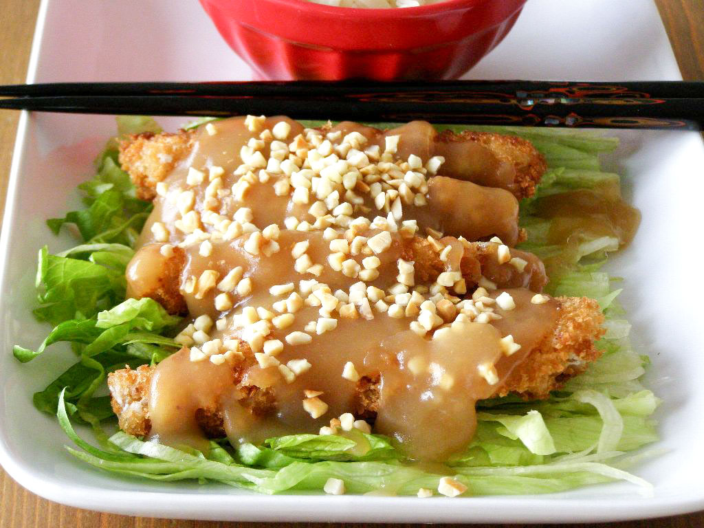 ... fried breaded 'chicken' with a soy sauce gravy and toasted almonds