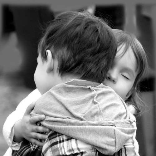 boy and girl hug