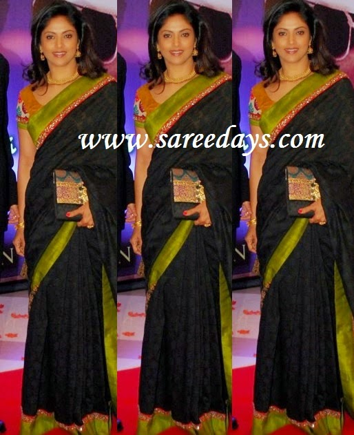 Latest saree designs nadiya in black super net designer saree checkout nadiya in black super net designer saree with red and gold small border and green border and paired with contrast short sleeves blouse altavistaventures Image collections