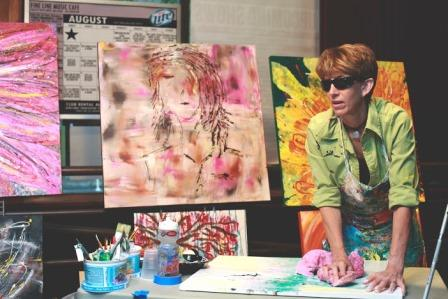 annie paints live during RAW event