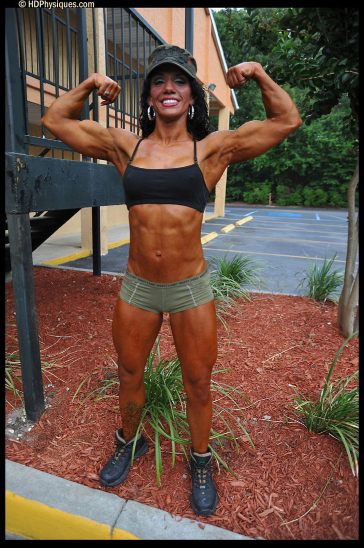 Sarah Martin Flexing Her Biceps And Abs