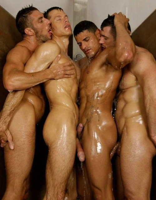 Naked guys shower together