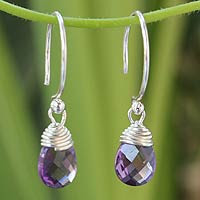 http://jewelry.novica.com/earrings/dangle/amethyst/amethyst-dangle-earrings-glowing-exotic/146419/
