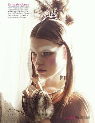 model wearing feathers, vogue beauty photographer, festival makeup