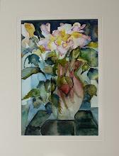 Halve vaas met bloemen