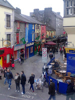View over Quay Street from Cross Street, looking towards Spanish Arch:  Dillons Claddagh ring museum, Wooden Heart Toys, Neachtains pub - rainy holiday Sunday crowds